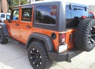 2011 Jeep Wrangler Unlimited Sport S 4-Door 4x4 Copper Pearl - Fred Pilkilton Motors - Denison Texas